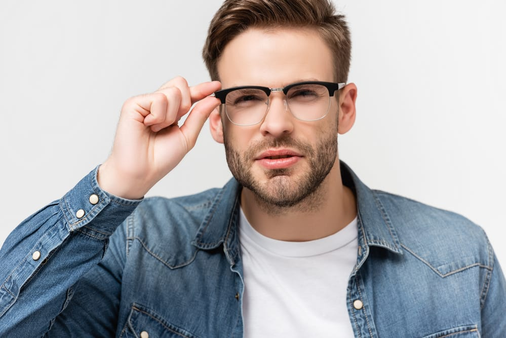 Young man wearing glasses squinting at something